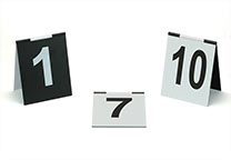 Number signs (several number ranges available), tent design, with hinge on the top. Black with white printing on one half, white with black printing on the other half. Dimensions: 9 x 11 cm.