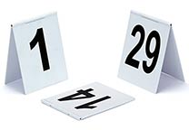 Number signs (several number ranges available), tent design, with hinge on the top. White with black printing. Dimensions: 9 x 11 cm.